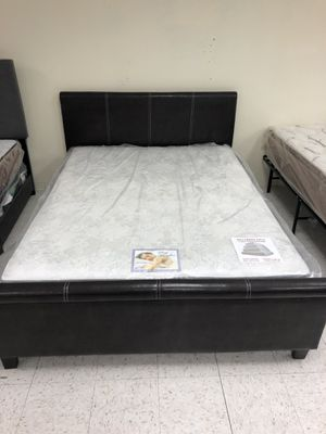 Platform queen size bed free regular queen size mattress included for Sale in Las Vegas, NV