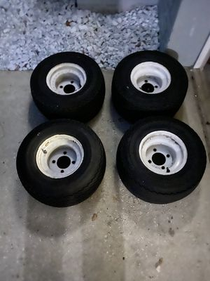 Golf cart tires in OK condition on the tread belt last for a while but at some point you'll have to change them out rims are in excellent condition for Sale in Palm Harbor, FL