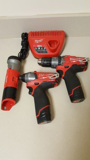 """MILWAUKEE M12 FUEL 12 Volt Cordless Brushless 2-Tool Combo Kit: 1/2"""" Hammer Drill and 1/4"""" Hex Impact Driver and M12 Milwaukee Light. for Sale in Renton, WA"""