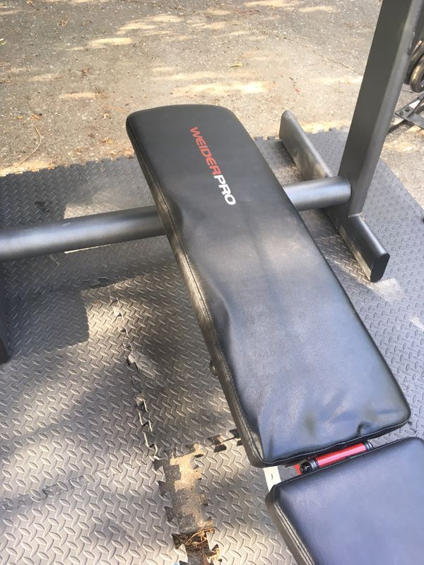 Olympic weight bench,Olympic bar, curl pad-250 lbs of weight+tree+mats