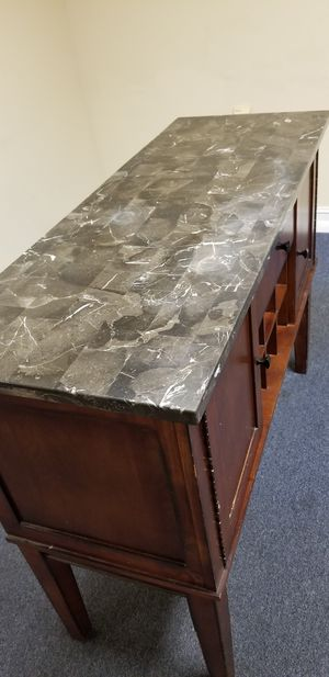 Nice side wood table with marble stone top for dining area or kitchen with wine rack for Sale in Pembroke Pines, FL