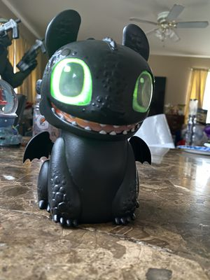 INTERACTIVE HOW TO TRAIN YOUR DRAGON TOOTHLESS TOY animatronic MAKES SOUNDS EYES LIGHT UP wings move ears move rocks back and forth. Batteries includ for Sale in Elgin, IL