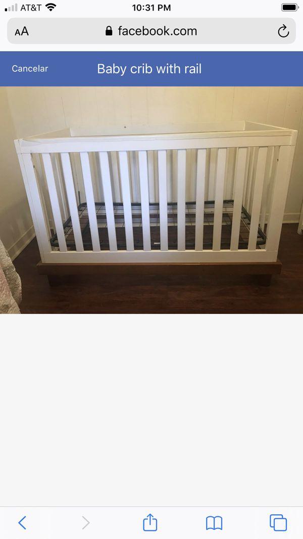 Baby crib with rail