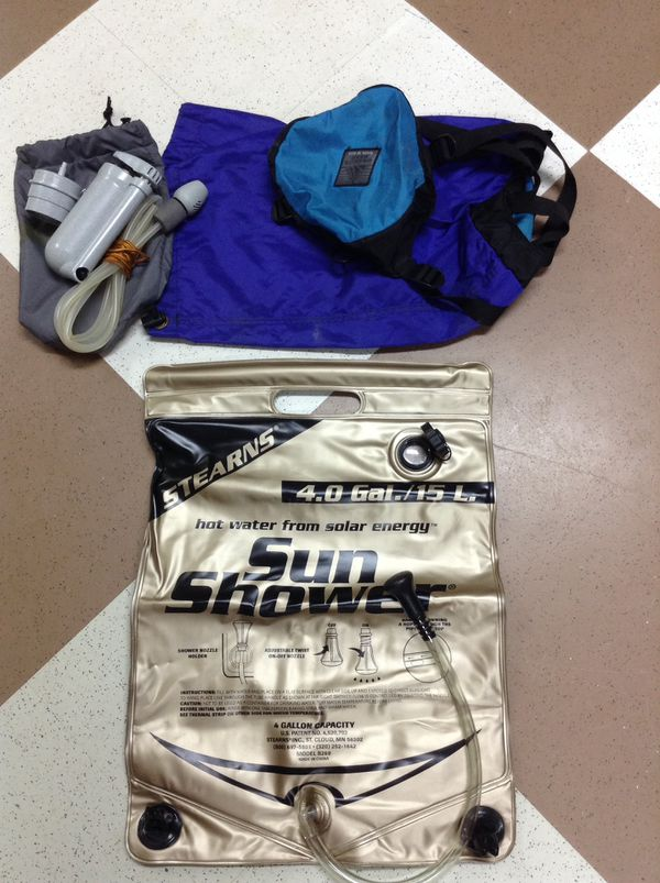 Eddie Bauer sleeping bag and stuff sack, compression sack, water purifier, hanging shower bag