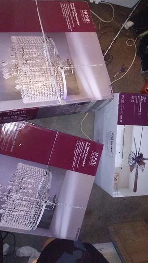Two brand-new chandeliers and brand new ceiling fan for Sale in Akron, OH