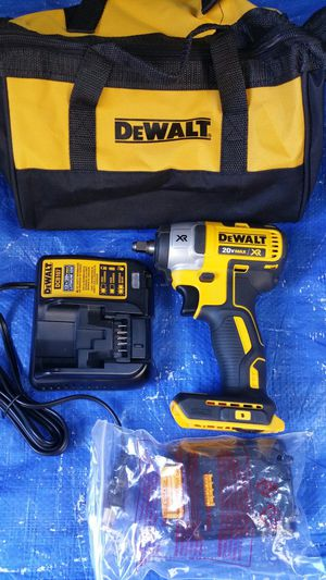 $175. DEWALT 20-Volt MAX XR Lithium-Ion Cordless 3/8 in. Brushless Impact Wrench Kit with Battery, Charger and Bag for Sale in Evergreen, CO