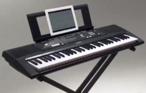 Yamaha EZ-220 61-Note Lighted Portable Keyboard with stand and music for Sale in Fort Lauderdale, FL
