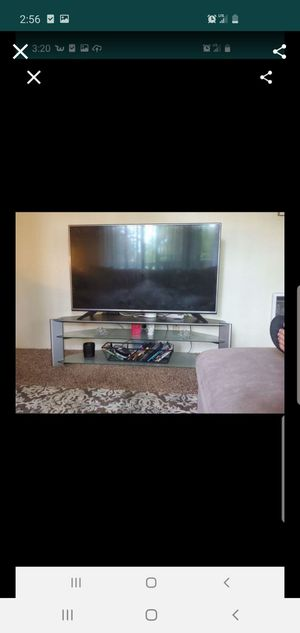 TV stand holds up to 55 inch tv for Sale in Lakewood, WA