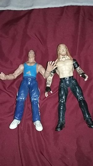 Kurt angle autographed action figure and the undertaker for Sale in Philadelphia, PA