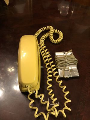 Vintage yellow trim line phone. 1980s. Can be used sitting on table or comes with hanging plate to hang on the wall. 18.00. Buda. 😀Johanna. Antique for Sale in Buda, TX