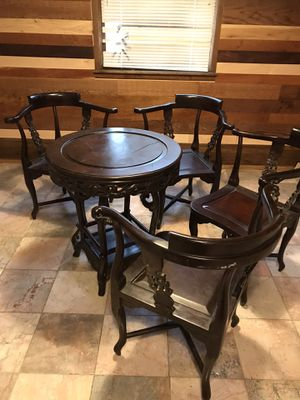 4 chairs and table with a wine rack all dark hand crafted wood for Sale in Derby, KS