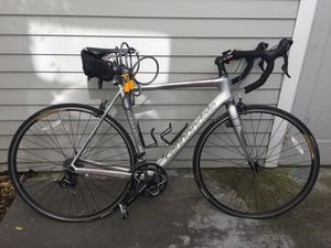 2010 silver Cannondale Six Carbon 5. 54in road bike with accessories for Sale in Berkeley, CA
