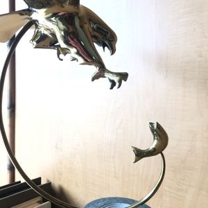 Mid century BIJAN Soaring brass Eagle sculpture swooping down to catch fish on marble pedestal. A beauty. for Sale in Pompano Beach, FL