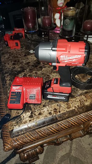M18 1/2 inch impact hide torque 1400 we 6.0 battery and charger for Sale in Hanford, CA