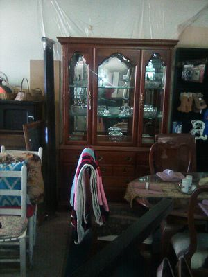 China cabinet with Crystal kitchen wear with 6chair dinette set with 2added slotsto table plus dinette comes with decoration on it for Sale in Indianola, MS