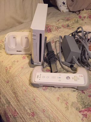 Wii Console with controller and controller stand for 2 controllers, stand for the console and controller handle for racing games!! Also have 2 games for Sale in Johnson City, TN