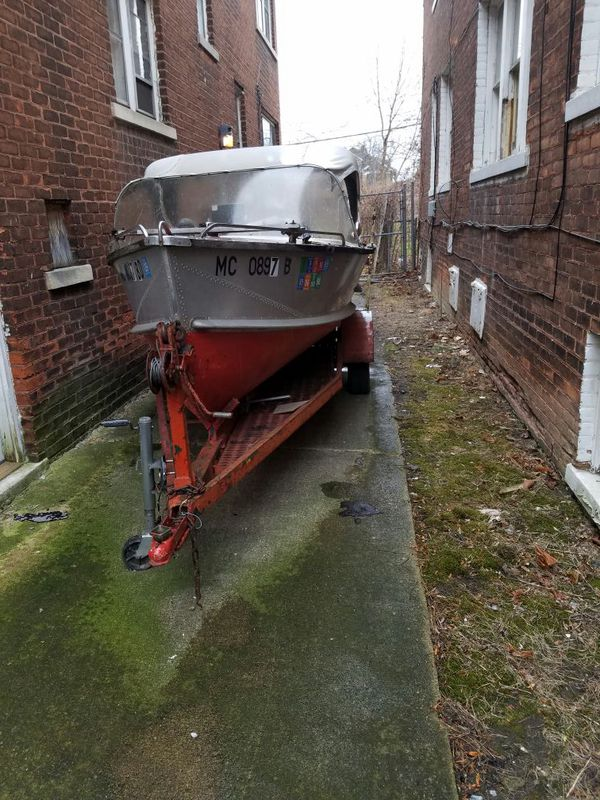 Aluminum boat with trailer and motor.