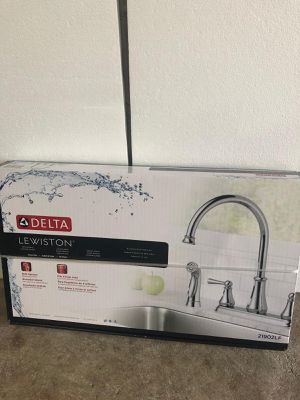 Delta Lewiston Two Handle Kitchen Faucet with Spray MODEL#: 21902LF Brand new Originally for $194 selling for 100 for Sale in High Point, NC