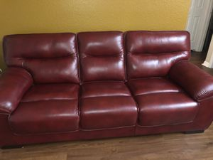 Like new Red Wine beautiful leather couch,love seat and 2 glass tables from Rooms to go $395 for Sale in Winter Springs, FL