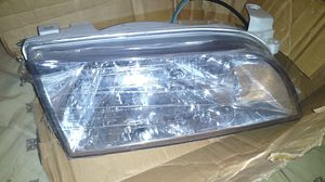 1993-97 Toyota Corolla right headlight grey for Sale in Hazard, CA