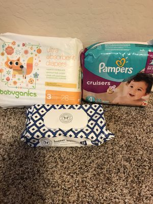 Baby diapers, wipes, and clothes hanger for Sale in Goodyear, AZ