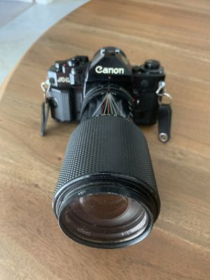 Canon A1 film camera with 75-210, 28mm, and 50mm lens. Also camera flash. for Sale in Oxford, FL