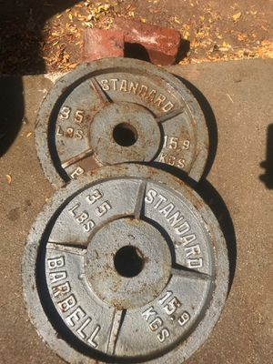 35 lb Olympic bar weights for Sale in Hesperia, CA