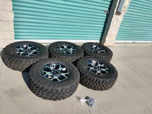 """Jeep Wrangler OEM wheels and tires 17"""" Falken M T tires 285/70/17 100 miles only for Sale in Montclair, CA"""