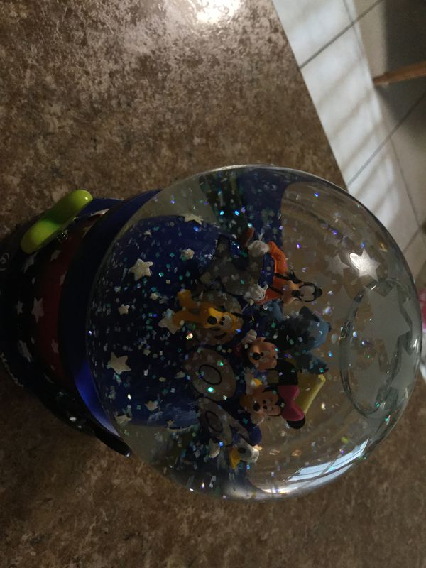 Retired disney world 2006 water globe. Musical.