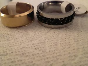 His and hers stainless steel rings in size 6 and 8 for Sale in Tacoma, WA