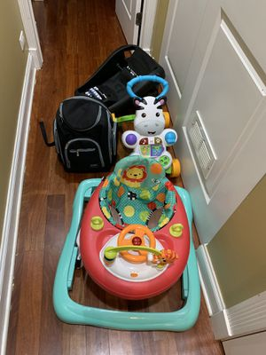Maxi Cosi car seat base. Walkers. Diaper bag. for Sale in Chicago, IL