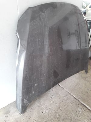 Ford taurus hood and 2016 chevy Sonic LT parts for Sale in Lakeland, FL