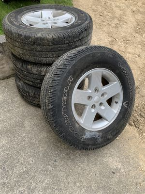 Stock Jeep wheels and tires for Sale in Pine Grove, PA