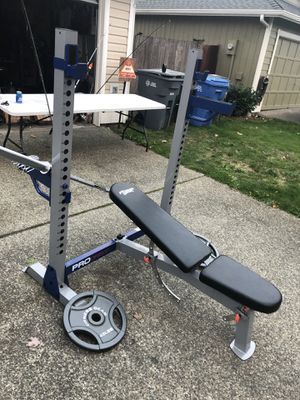 New bar new squat rack bench press combo new 45 pound weight for Sale in Puyallup, WA