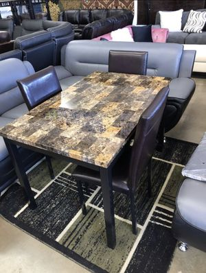 Furniture table with four El Rio furniture finance available down payment $39 1456 belt line rd suite 121 Garland tx 75044 Open from 9:30-8:30 for Sale in Garland, TX