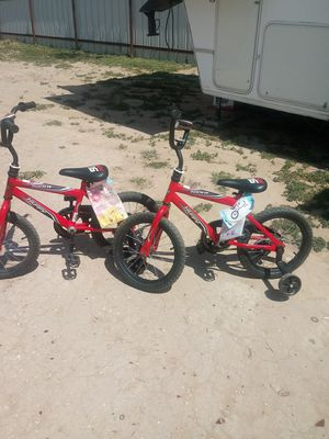 """Two 16 """" little boys bikes. Only rode on them 3 times in back yard. With traini g wheels $45 for both for Sale in San Angelo, TX"""