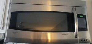 Ge microwave like new for Sale in North Palm Beach, FL