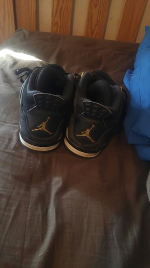 Jordan 4 black and gold for Sale in Detroit, MI