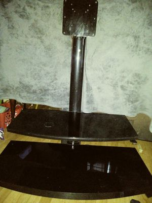 Black Flat screen TV stand holds up to a 40 inch for Sale in Providence, RI