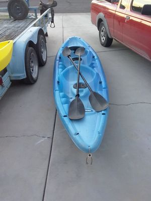2 person kayak and paddles light weight and easy to carry and haul has storage compartments for both seats for Sale in Mesa, AZ