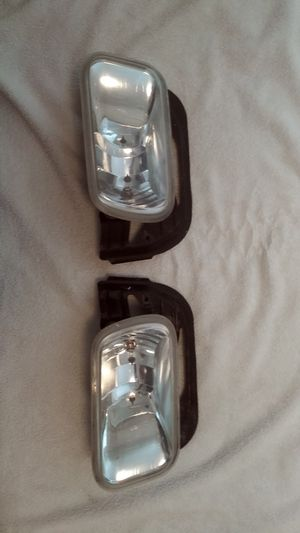 Fog lights with brakets for Dodge Ram Truck. Mine was 2010 model so will fit same body style. for Sale in LAUD LAKES, FL