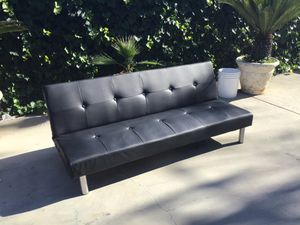 Black finish leather folding futon sofa bed with chrome finish legs for Sale in Los Angeles, CA
