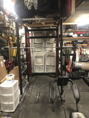 Squat Rack, Barbell and Olympic Plates for Sale in Wantagh, NY