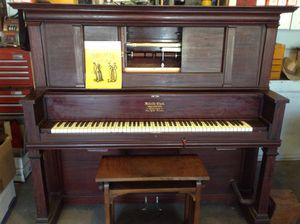 Melville Clark player piano in good working condition, Circa late 1800s With lots of rolls, The player works and bellows have been rebuilt. for Sale in Wrightwood, CA