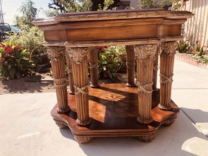 An antique end table with eight Roman pillars。It's very heavy, but it can be dismantled. for Sale in Cypress, CA