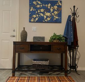 Console sofa table designed by Ashley Furniture Kordell collection for Sale in Phoenix, AZ