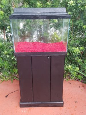 20 gallon fish tank with stand , hood, florescent light and neon red rocks for Sale in Miami, FL