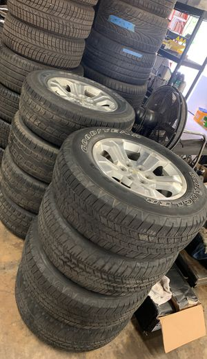 Silverado 1500 rims with tires 275/65/18 for Sale in Tampa, FL