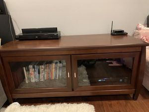 Tv Stand - 2 glass doors with shelves for Sale in Irvine, CA