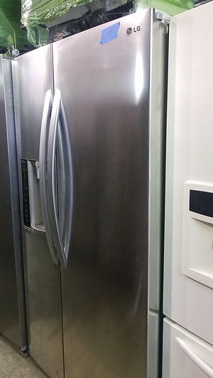 Lg side by side refrigerator brand new scratch and dent 6 months wa for Sale in Baltimore, MD